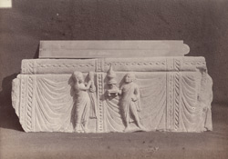 Fragment of Buddhist sculpture showing a female devotee worshipping a lamp held up by a monk, Peshawar District